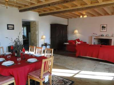 The lounge and dining room are very spacious and have access to the garden via the French doors.